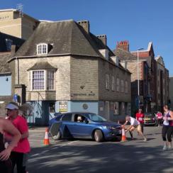 woman drives car plymouth half marathon video