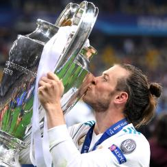 Gareth Bale kisses the trophy after his goals give Real Madrid the Champions League title