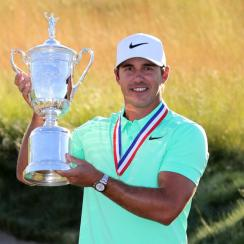 Brooks Koepka poses with the U.S. Open trophy and his gold medal at the 2017 U.S. Open at Erin Hills.