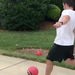 Graham GAno playing kickball with family