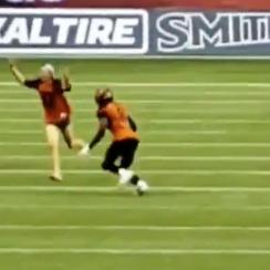 Fan runs on the field and gets tackled at a CFL game