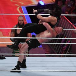 Brock Lesnar taking down Roman Reigns at WWE SummerSlam