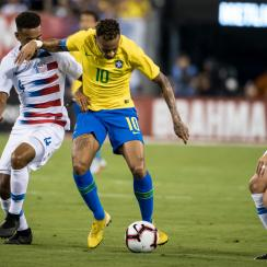Tyler Adams and Wil Trapp defend Neymar in the USA's loss to Brazil