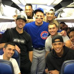 Cubs' Anthony Rizzo wears uniform on plane (photo)