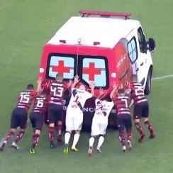 Players push ambulance off field