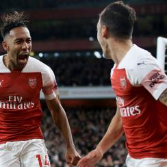 Pierre-Emerick Aubameyang and Mesut Ozil celebrate in Arsenal's win over Leicester City