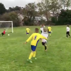 Dad pushes kid to make save in youth soccer game (video)