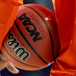 College basketball corruption scandal schools involved