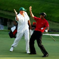 Steve Williams and Tiger Woods celebrate Woods' chip-in on the 16th hole at the 2005 Masters.