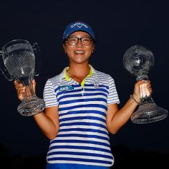 Lydia Ko poses with the CME Tour Championship trophy and the CME Race for the Globe trophy following the final round of the CME Group Tour Championship in Naples on Sunday.