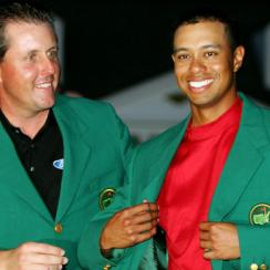 Phil Mickelson presents Tiger Woods with a fourth green jacket in 2005, Woods' last Masters victory.