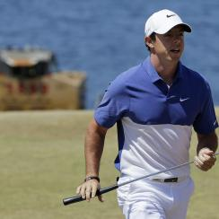 FILE - A Sunday, June 21, 2015 file photo showing Rory McIlroy, of Northern Ireland, walking off the second green during the final round of the U.S. Open golf tournament at Chambers Bay in University Place, Wash. World number one Rory McIlroy has