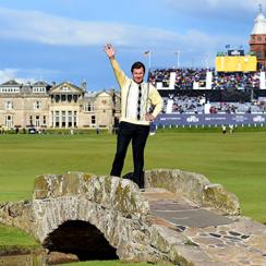 Sir Nick Faldo of England waves to the crowd as he stands on Swilcan Bridge during the second round of the 144th Open Championship at The Old Course on July 17, 2015 in St Andrews, Scotland.