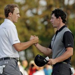 Jordan Spieth shakes hands with Rory McIlroy on the 18th green following the second round of the 2014 Masters.