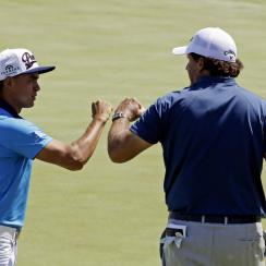 Phil Mickelson fist pumps Rickie Fowler on the 17th green during a practice round for the PGA Championship on Tuesday, Aug. 11, 2015, at Whistling Straits in Haven, Wisconsin.