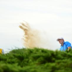 Jordan Spieth chips out of a bunker on the 15th hole during the final round of the PGA Championship at Whistling Straits.