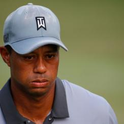 Tiger Woods reacts after a par putt on the 17th green during the third round of the Wyndham Championship at Sedgefield Country Club on August 22, 2015 in Greensboro, North Carolina.