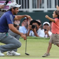 Jason Day, of Australia, is congratulated by his son Dash after winning The Barclays golf tournament Sunday, Aug. 30, 2015.