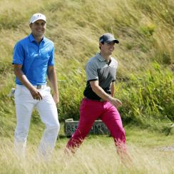 Jordan Spieth and Rory McIlroy smile as they walk to the fifth green during the first round of the 2015 PGA Championship.