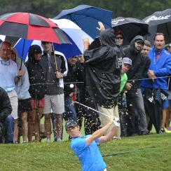 Rory McIlroy hits from bunker on the first hole during the third round of the Tour Championship golf tournament at East Lake Golf Club, Saturday, Sept. 26, 2015, in Atlanta. (AP Photo/John