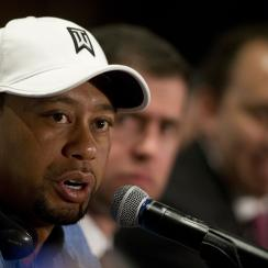 Tiger Woods responds to a question during a press conference to launch the Bridgestone America's Golf Cup in Mexico City on Tuesday, Oct. 20, 2015. Woods withdrew from the Bridgestone America's Golf Cup and two other events he had planned to play this year.