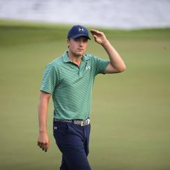 Jordan Spieth of the United States walks off the 18th hole after the final round of the SMBC Singapore Open golf tournament at Sentosa Golf Club's Serapong Course on Monday, Feb. 1, 2016, in Singapore. (AP Photo/Wong