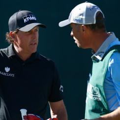 "Phil Mickelson strategizes with his caddie Jim ""Bones"" Mackay during the 2016 Waste Management Phoenix Open"