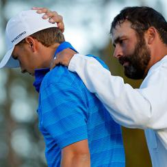 Jordan Spieth is consoled by caddie Michael Greller after his round.