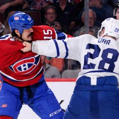 An opening night fight between George Parros and Colton Orr kept hockey's fight debate simmering.