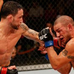 Frankie Edgar (left) delivers a punch to Cub Swanson during their Nov. 22 featherweight bout in Austin.