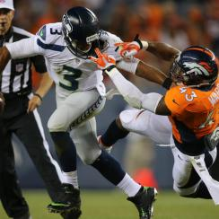 Safety T.J. Ward (right) is a big part of Denver's redefined defense.