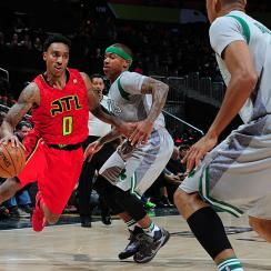 Hawks point guard Jeff Teague drives to the basket against Isaiah Thomas of the Boston Celtics.