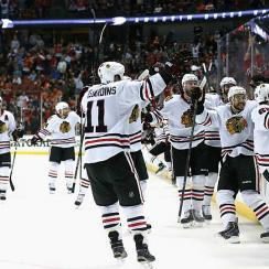 The Blackhawks mob Marcus Kruger (16) after he scored at 16:12 of the third OT to beat the Ducks in Game 2 of the Western Conference finals.