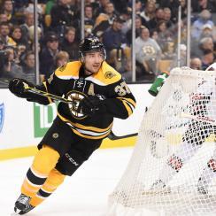 Patrice Bergeron of the Boston Bruins wears the CCM Resistance Helmet during a game against the Ottawa Senators in Boston, Massachusetts.