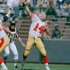 Baltimore Stars Chuck Fusina launches a 79-yard touchdown to teammate Victor Harrison against the Oakland Invaders.