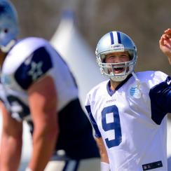 Dallas Cowboys quarterback Tony Romo call an audible as the offense runs a play at NFL training camp, Saturday, July 26, 2014, in Oxnard, Calif.