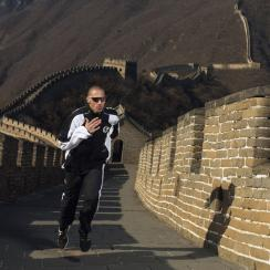 Jeremy Wariner of the USA runs up the Great Wall of China at Mutianyu