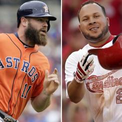 L: Evan Gattis of the Astros. R: Jhonny Peralta of the Cardinals.