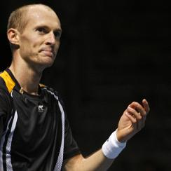 Davydenko celebrates after beating Federer in the 2009 ATP World Tour Finals semi-final match.