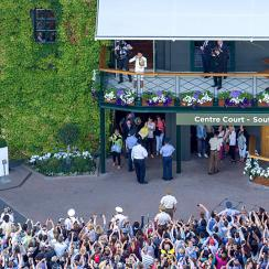 Novak Djokovic shows off the Wimbledon trophy shortly after taking down Roger Federer in the final.