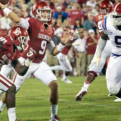 Louisiana Tech DL Vernon Butler (No. 9) pressures Oklahoma QB Trevor Knight.