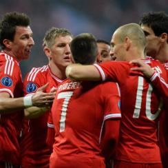 Bayern Munich players celebrate following a goal that all but sealed their place in the Champions League quarterfinals