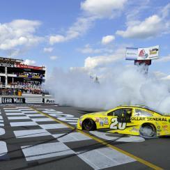 Matt Kenseth smokes his tires after winning the NASCAR Pocono 400 auto race, Sunday, Aug. 2, 2015, in Long Pond, Pa. (AP Photo/Derik Hamilton)