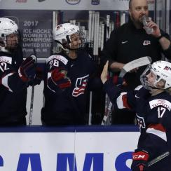 United States forward Jocelyne Lamoureux-Davidson is congratulated by teammates after scoring during the second period of a IIHF Women's World Championship semifinal hockey tournament game against Germany, Thursday, April 6, 2017, in Plymouth, Mich. (AP P