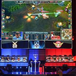FILE - In this Oct. 4, 2013, file photo, the teams of China's Royal Club, left, and South Korea's SK Telecom T1 compete at the League of Legends Season 3 World Championship Final in Los Angeles. Robert Morris University Illinois, a small private universit