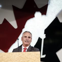FILE - In this July 25, 2017, file photo, former Vancouver Canucks head coach Willie Desjardins, who will be Team Canada's head coach for the 2017-2018 season, speaks at a news conference in Calgary, Alberta. The United States and Canada are taking drasti