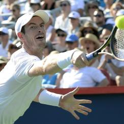 Andy Murray, of Great Britain, lunges for a return to Novak Djokovic, of Serbia, during the men's final at the Rogers Cup tennis tournament in Montreal on Sunday, Aug. 16, 2015.(Paul Chiasson/The Canadian Press via AP)