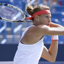 Lucie Safarova, of the Czech Republic, returns the ball to Belinda Bencic, of Switzerland, during a match at the Western & Southern Open tennis tournament, Thursday, Aug. 20, 2015, in Mason, Ohio. (AP Photo/John Minchillo)