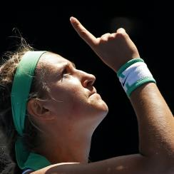 Victoria Azarenka of Belarus reacts after defeating Barbora Strycova of the Czech Republic in their fourth round match at the Australian Open tennis championships in Melbourne, Australia, Monday, Jan. 25, 2016.(AP Photo/Vincent Thian)