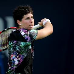 Carla Suarez Navarro from Spain returns the ball to Caroline Garcia of France during the third day of the Dubai Tennis Championships in Dubai, United Arab Emirates, Wednesday, Feb. 17, 2016. (AP Photo/Kamran Jebreili)